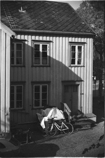 House with the bike. Black?