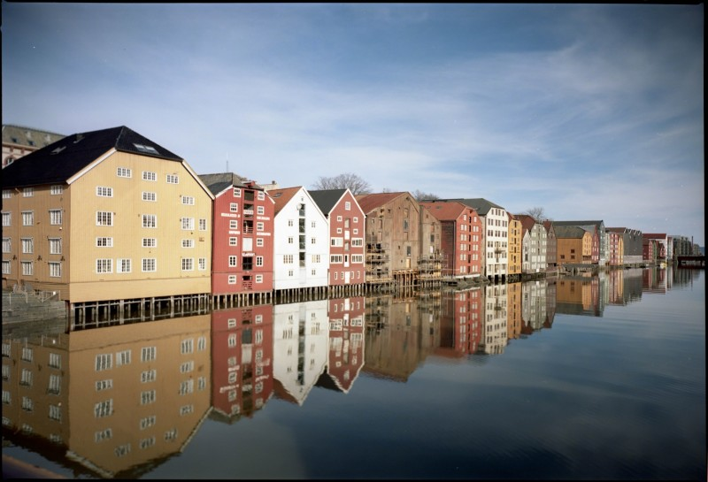 Old wharves of Trondheim with swing
